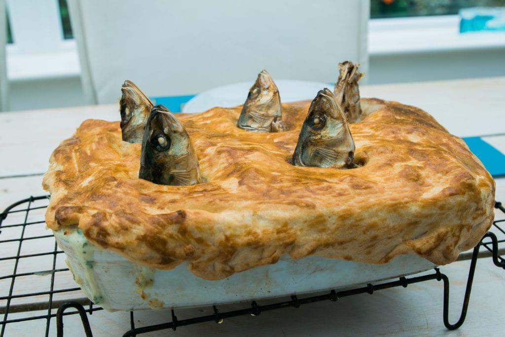 Stargazy Pie Mousehole Cornwall England UK by Davis Dorss Shutterstock