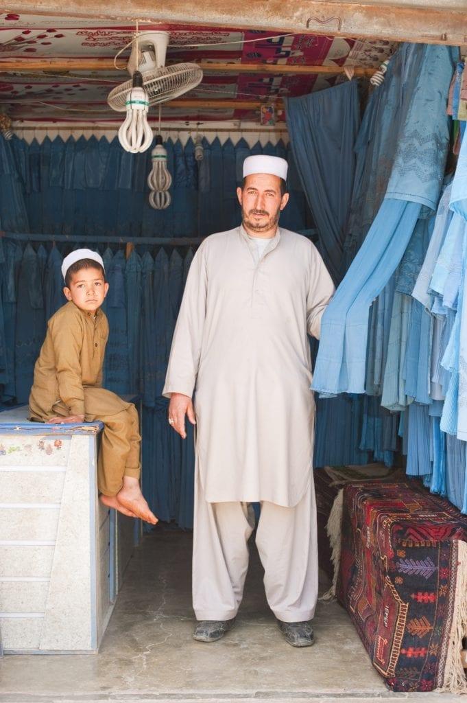Burqa seller Herat Afghanistan by Simon Urwin