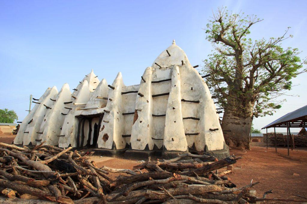 Larabanga Mosque Ghana travel winter sun by Sura Nualpradid Shutterstock