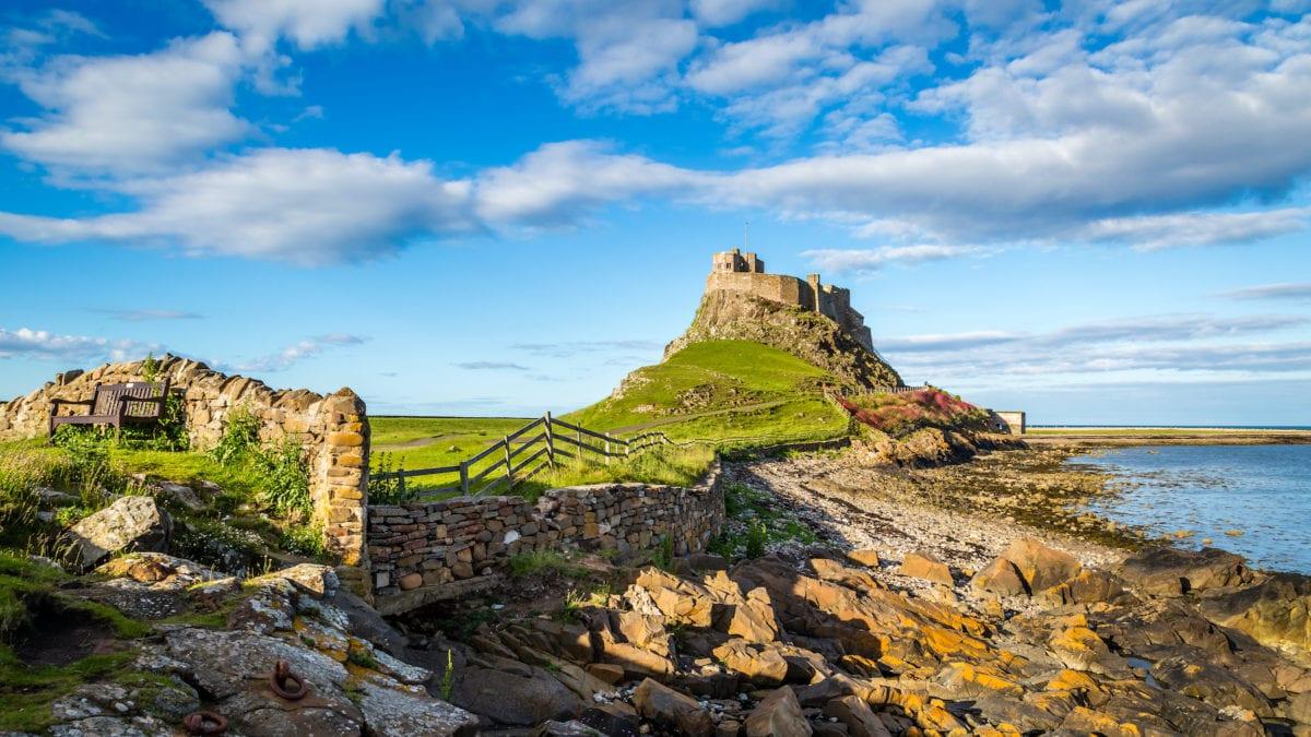 Lindisfarne Castle Northumberland by Michael Conrad Shutterstock alternative British summer guide