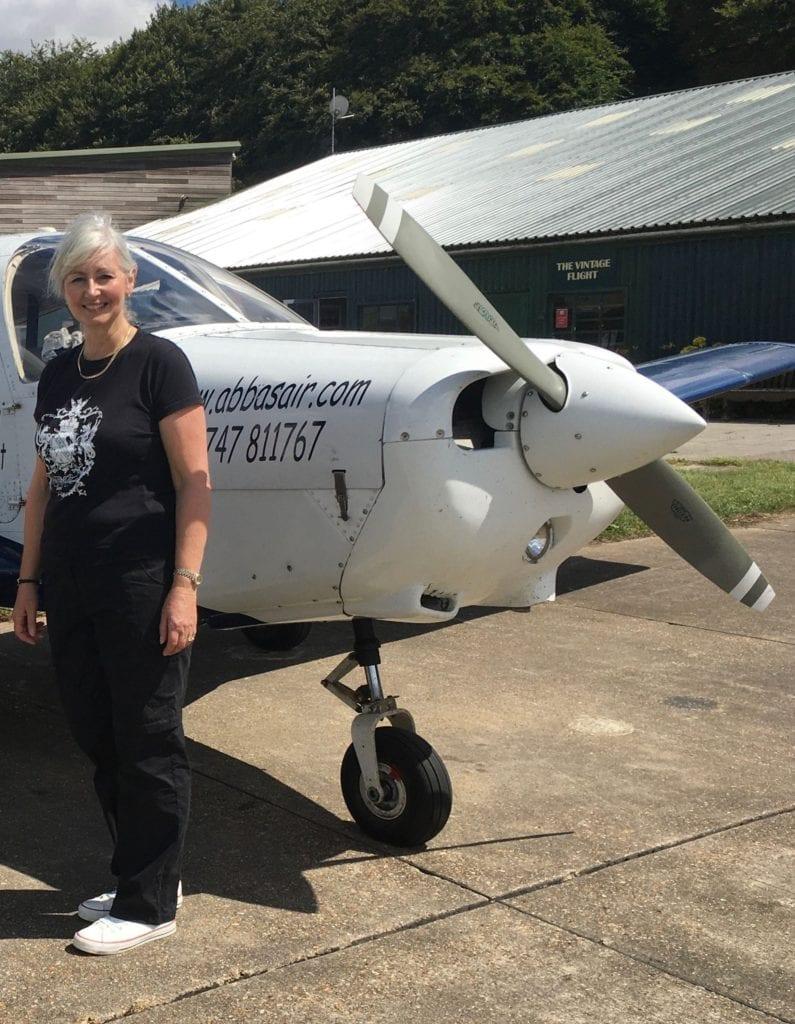 Juicy Crones Andie by her plane