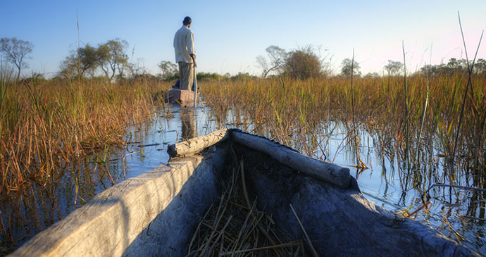 Boat on the Okavango Delta, Botswana by PlusONE, Shutterstock best wetlands in the world