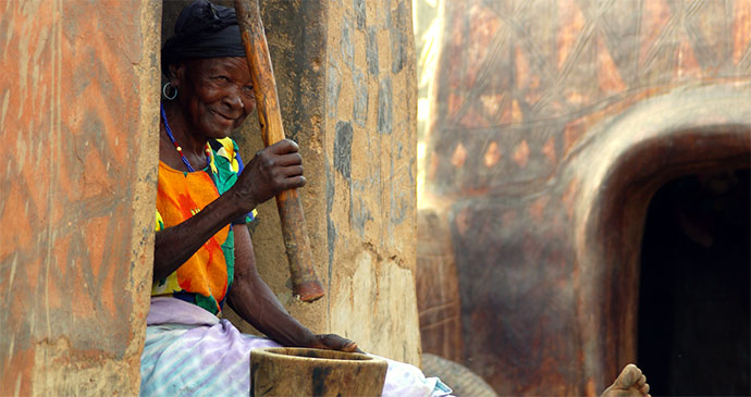 Millet pounding Burkina Faso Africa by Katrina Manson and James Knight
