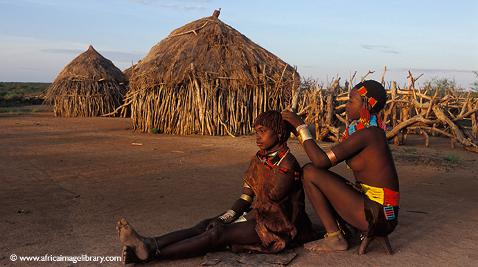 Hamer women applying ochre, South Omo, Ethiopia by Ariadne Van Zandbergen