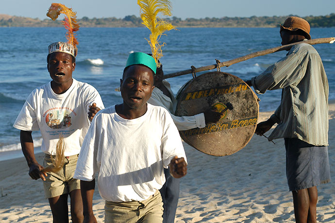 Locals entertaining the guests of the Chintheche Inn, Chintheche Malawi by Malawi Tourism