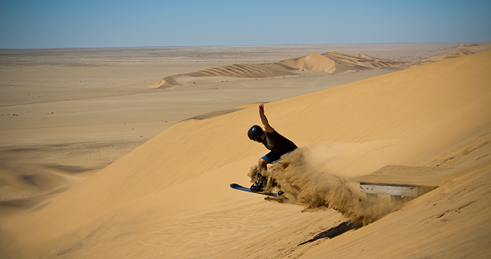 Sandboarding desert Namibia by Luke Price, Flickr