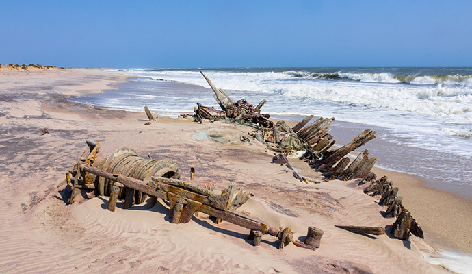 rusting shipwreck, Skeleton Coast, Namibia by  Ian D M Robertson, Shutterstock