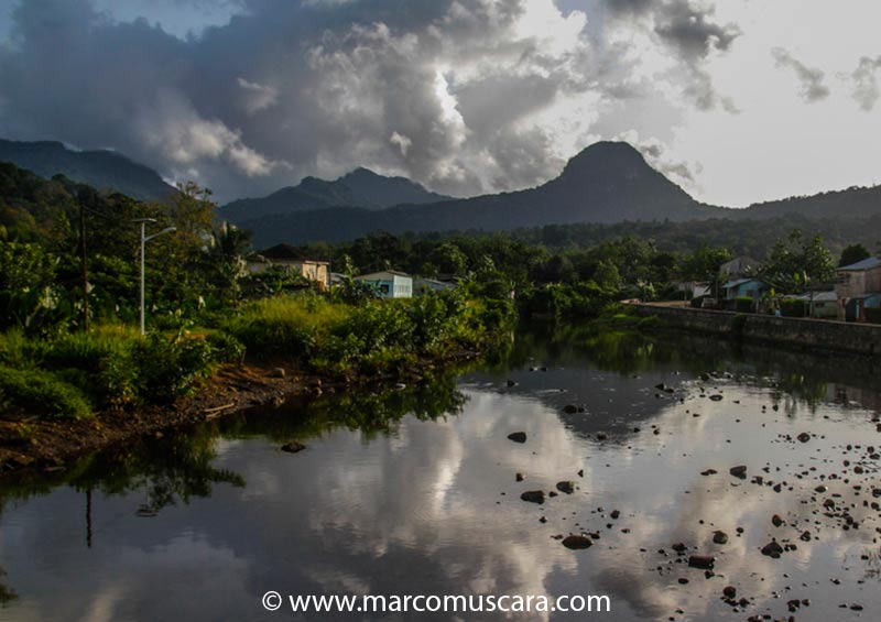 Papagaio river with Pico Papagaio at the bottom in Príncipe, São Tomé and Príncipe by Marco Muscarà