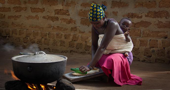 woman cooking Sierra Leone by robertonencini Shutterstock