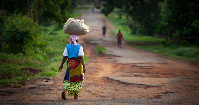 Woman walking Sierra Leone by robertonencini Shutterstock