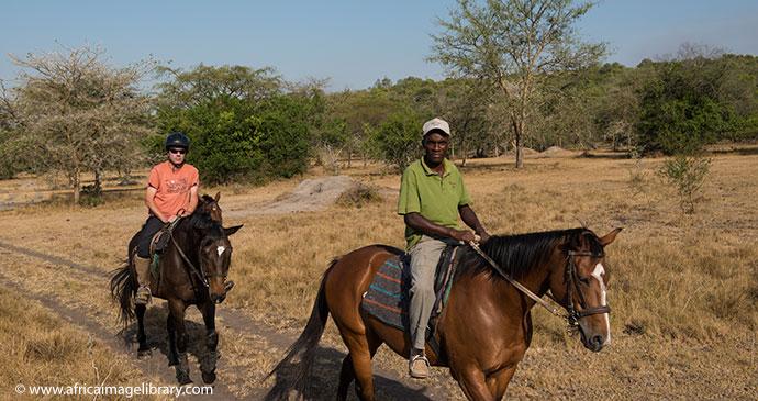 Horseback safari Lake Mburo Uganda by Africa Image Library
