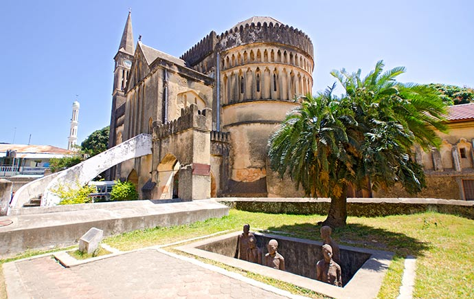 Slave Market Memorial church in the background  Stone Town Zanzibar Island  Tanzania by tr3gin, Shutterstock