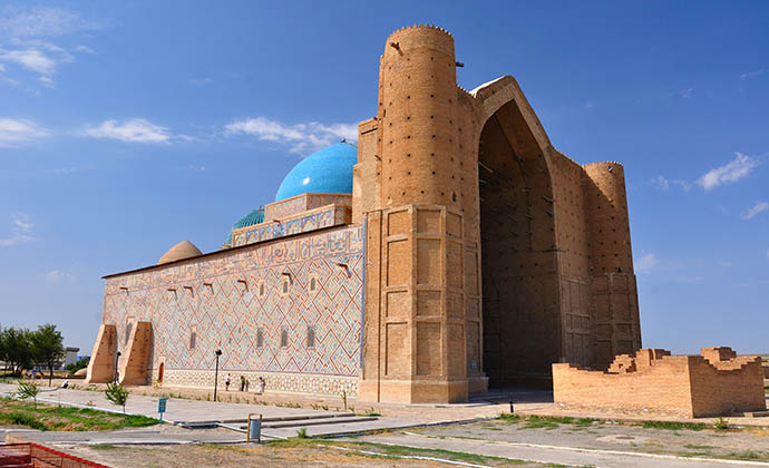 Mausoleum of Khoja Ahmed Yassaui Turkestan Kazakhstan by Djusha, Shutterstock