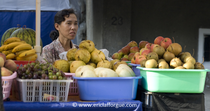 A market stall in Pyongyang, North Korea by Eric Lafforgue, www.ericlafforgue.com