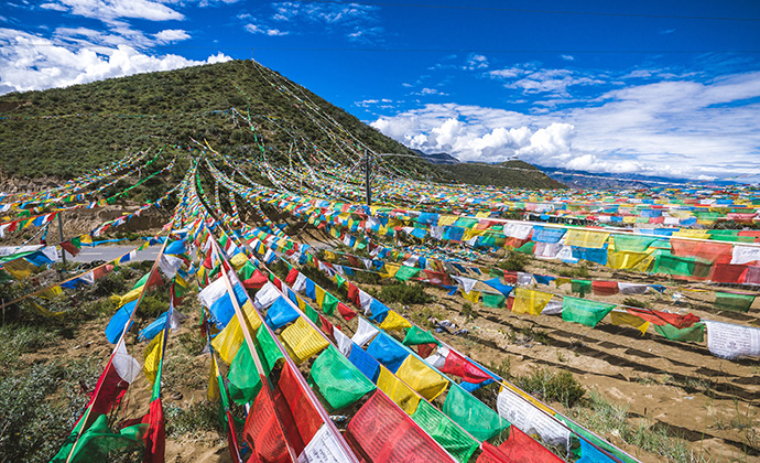 Prayer flags Tibet China by Vladimir Zhoga, Shutterstock