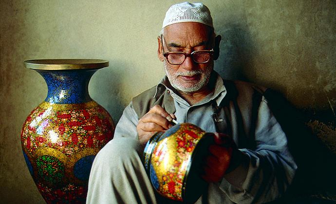 An artisan painting pots, Kashmir, India by J&K Tourism