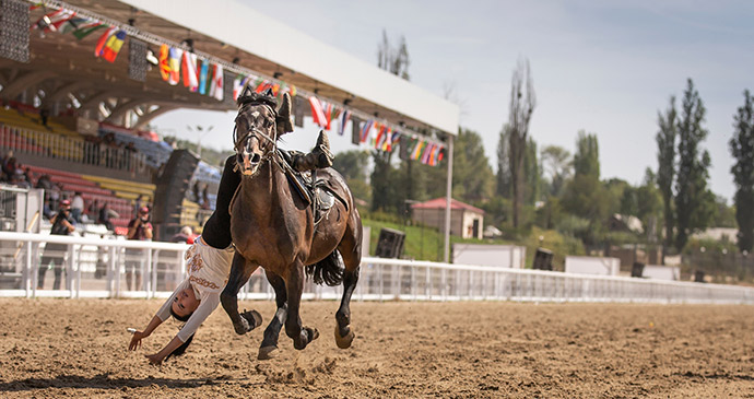 horseback gymnastics, World Nomad Games, Kyrgyzstan by Katiekk, Shutterstock