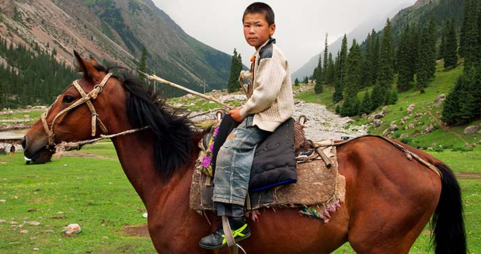 Kyrgyz child on horseback, Kyrgyzstan by Radiokafka, Shutterstock