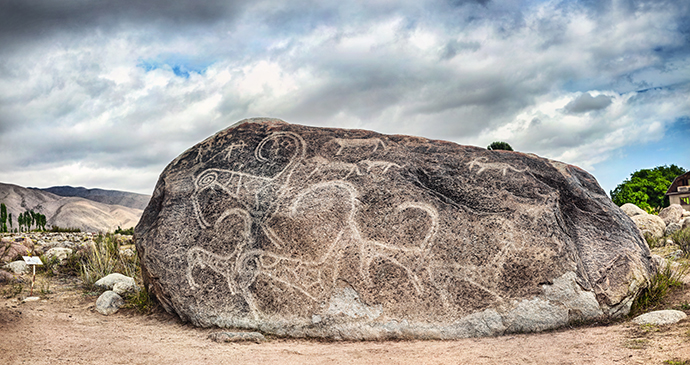 Saimaluu-Tash Petroglyphs, Kyrgyzstan by Pikozo.kz, Shutterstock