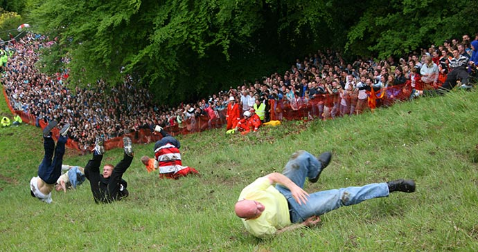 Cheese Rolling, Cooper's Hill, Cotswolds, England by Colin Young