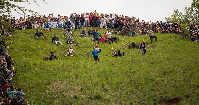Cheese rolling, Cooper's Hill, Cotswolds, British Isles by PhotoFabs