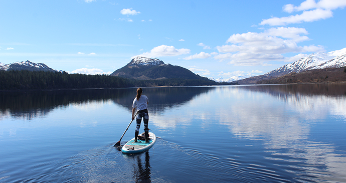 Lizzie Carr on a Stand Up Paddle Board on Loch Laggan, Scotland © Lizzie Carr