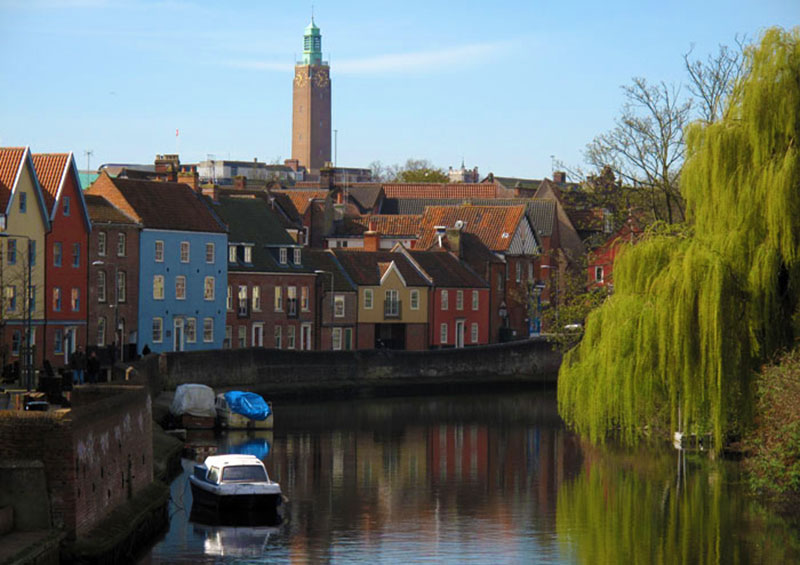 The clock tower of Norwich City Hall seen from the River Wensum Norfolk UK by Laurence Mitchell walking route