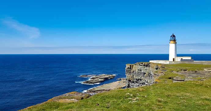 Noup Head lighthouse Orkney by Chris Noe, Shutterstock cliff walks