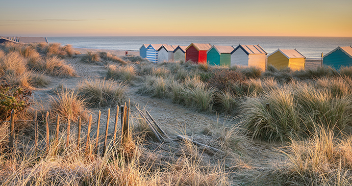 Colourful beach huts along Southwold's coast by Philip Ellard, Shutterstock