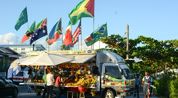 Fruit stand Georgetown Guyana by M M, Wikimedia Commons