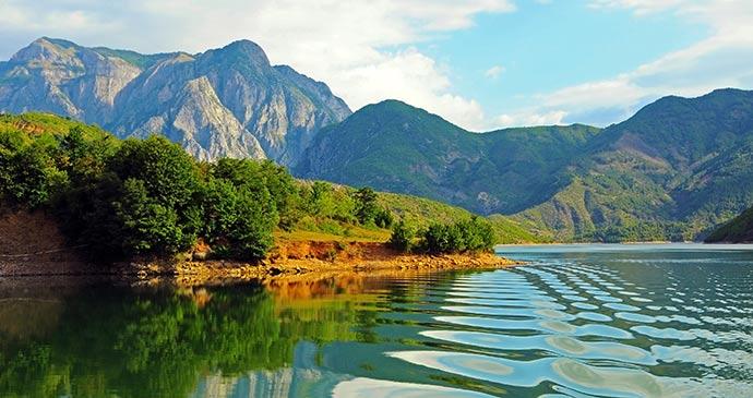 Lake Komani, Albania by Przemyslaw Wasilewski, Shutterstock