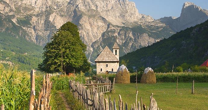 Catholic church, Thethi Valley,Albania by ollirg, Shutterstock