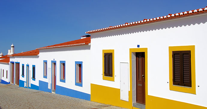 Painted Houses Alentejo Portugal Europe by Inacio Pires, Shutterstock