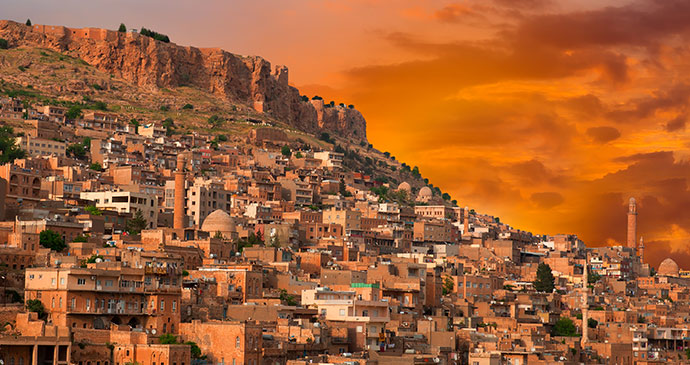 evening view of old town of mardin in eastern turkey by muratart shutterstock
