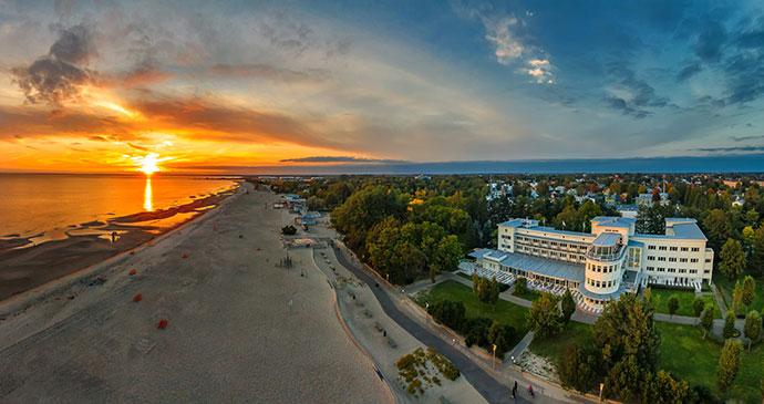 sunset Parnu beach Estonia by Kristian Pikner Wikimedia alternative beach destinations europe