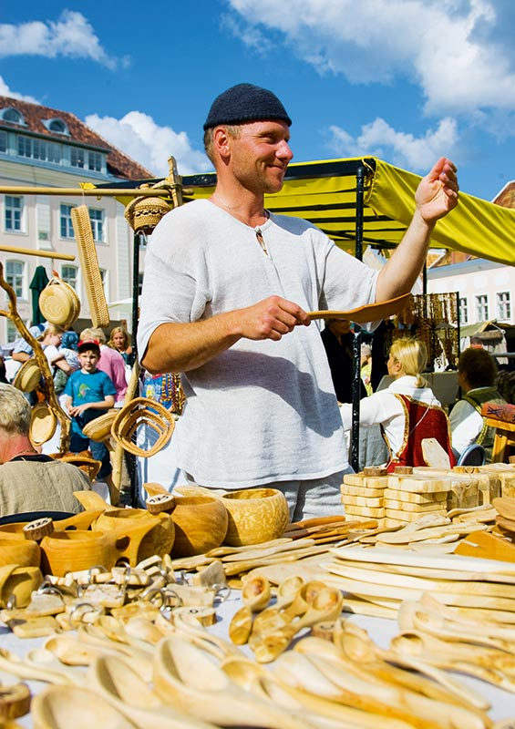A seller at a market in Tallinn, Estonia by Visit Estonia