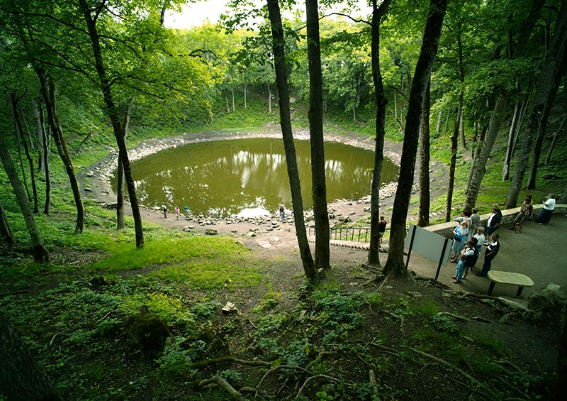 The Kaali crater, caused by a falling meteor, Estonia by Visit Estonia