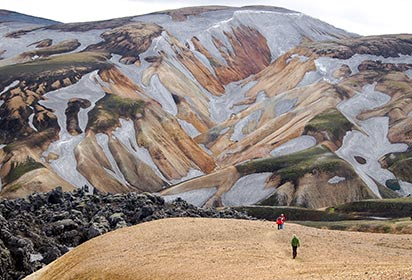 Trekkers on the lava field at Landmannalaugar by Nicram Sabod, Shutterstock
