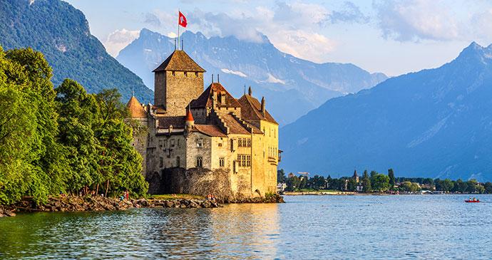 Chillon Castle Lake Geneva, by FenlioQ Shutterstock