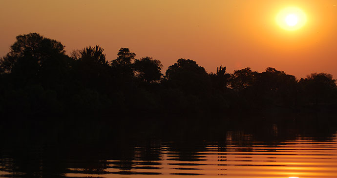Sunset over Kafue National Park by Tricia Hayne