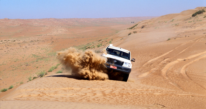 Wadi bashing, Wihibah Sands, Oman by Oman Ministry of Tourism