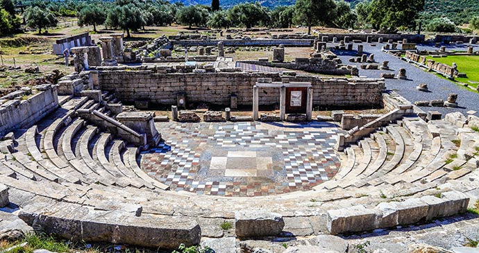 Ruins theatre Ancient Messene Peloponnese Greece Europe by elgreko Shutterstock