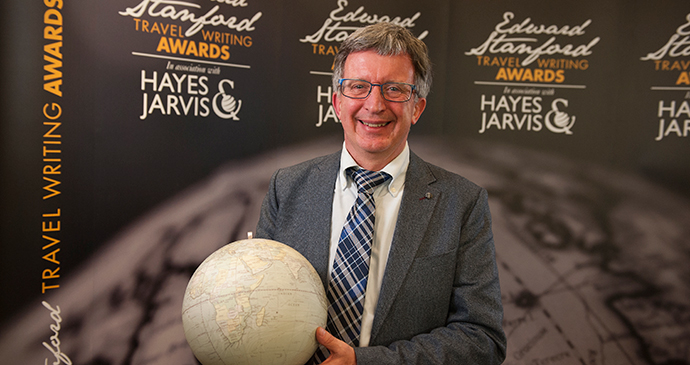 Alan Packer, winner of the Bradt New Travel Writer of the Year Award at the Edward Stanford Travel Writing Competition, with his antique globe trophy.