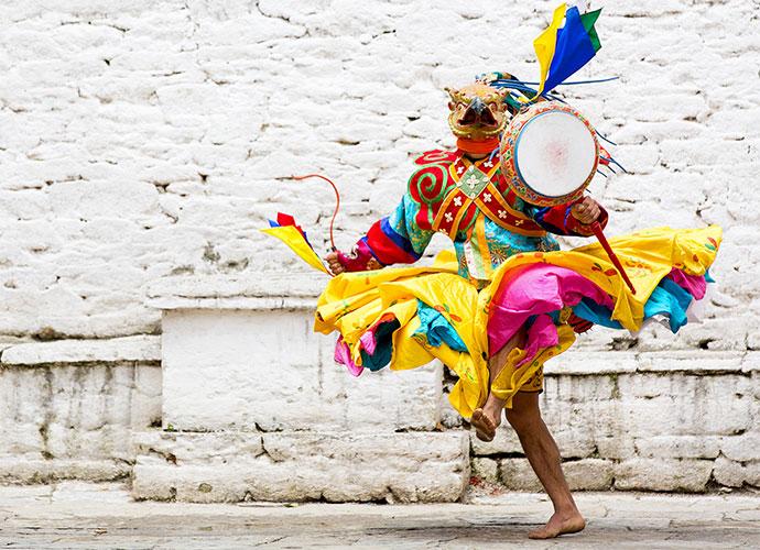 Eagle masked dancer Bhutan by letusgophoto